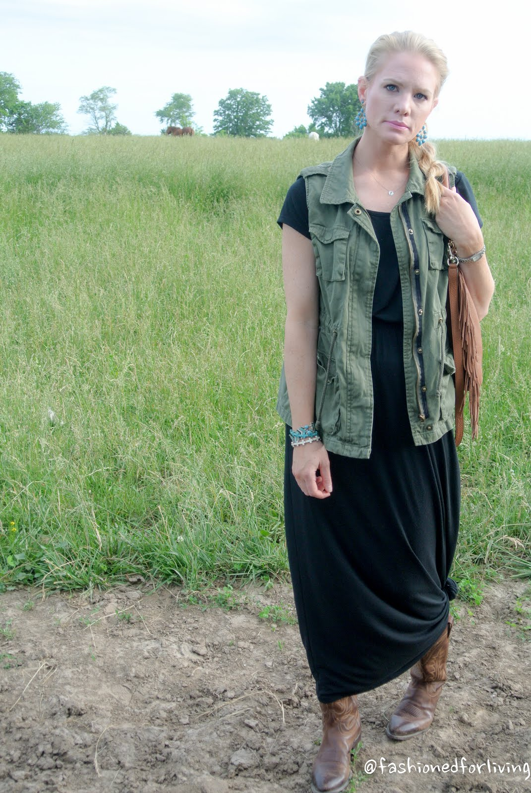 Black black t shirt maxi dress - Maxi Dress And Cowboy Boots Outfit With Military Vest And Fringe Bag T Shirt Dresses