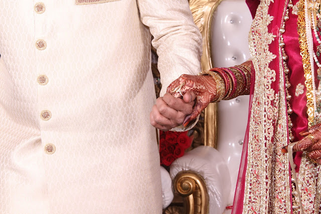Bride holding the hand of Groom - Pakistani Marriages