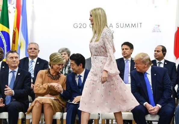 Queen Maxima wore a dress by Natan. Ivanka Trump wore Valentino Snowdrop print silk midi dress. Justin Trudeau