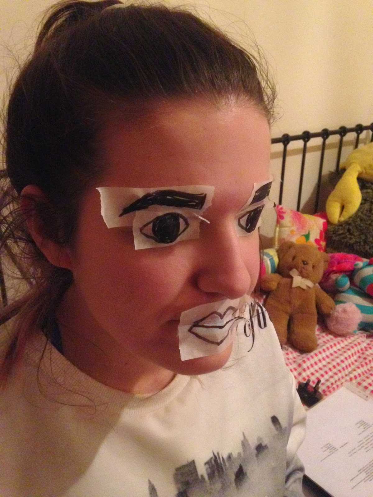 Tape face doll