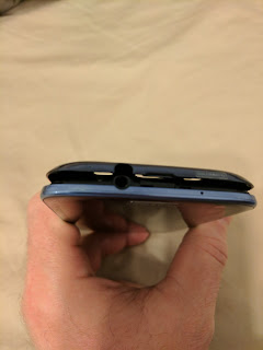 The Samsung Galaxy S3 with the back cover starting to pry off.