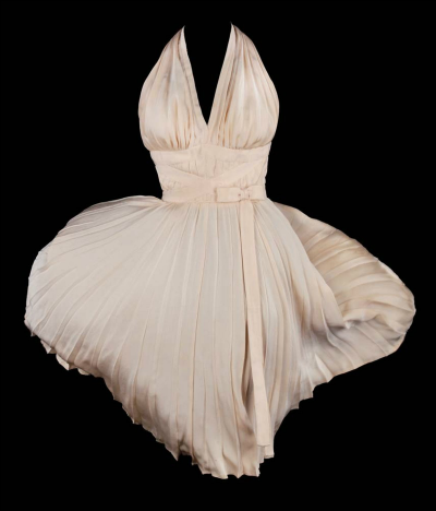 Front view of ivory colored dress with pleated skirt and halter neck designed by William Travilla for Marilyn Monroe in The Seven Year Itch