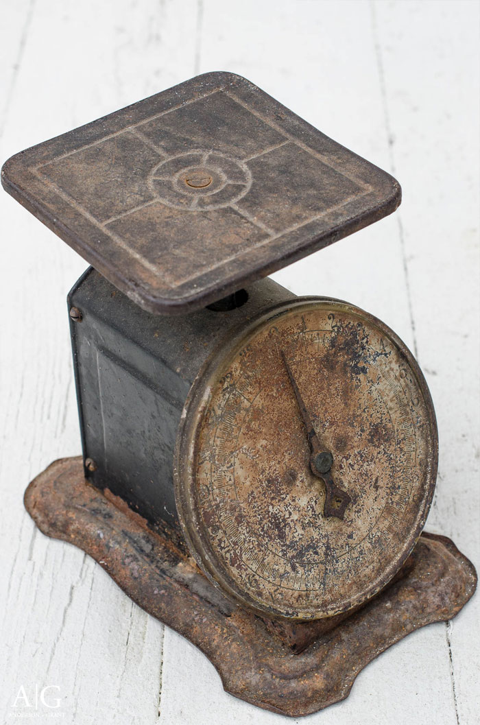 A rusty vintage kitchen scale