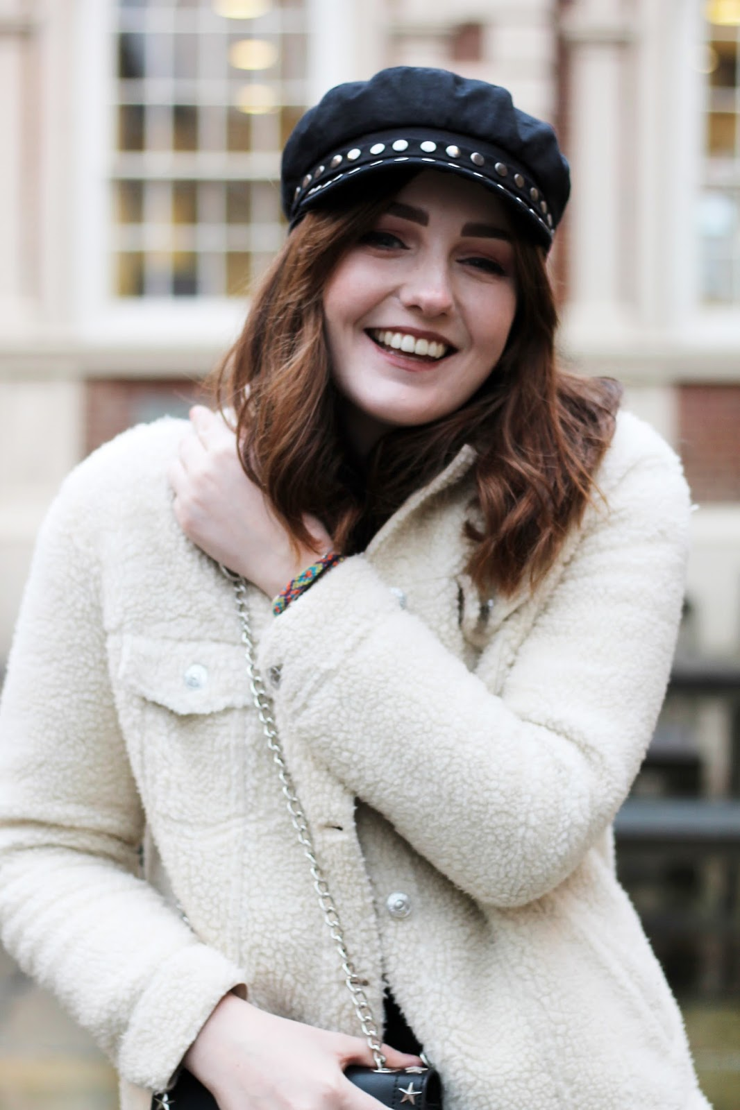 style blogger in topshop black baker boy cap with silver stud detail and river island cream borg trucker jacket