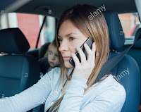 Parents indulge in risky behavior, using phone and texting while driving with children in the car