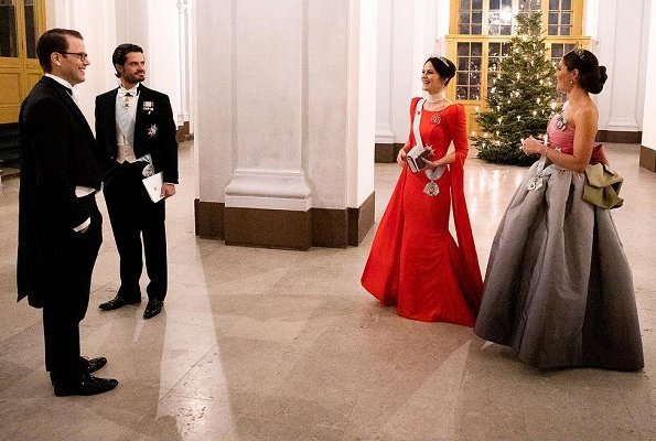 Queen Silvia, Prince Daniel, Prince Carl Philip. Princess Sofia wore a red dress. Crown Princess Victoria wore her mother's gown