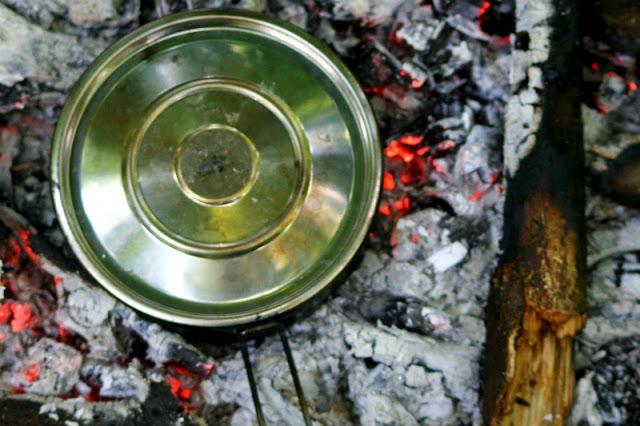 the pot set on the hot coals