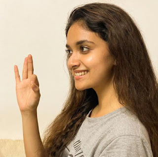 Keerthy Suresh in Yash Color T-Shirt with Cute and Awesome Lovely Chubby Cheeks Smile at her Home