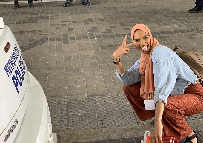 Black Muslim woman fights off Islamophobes with a smile