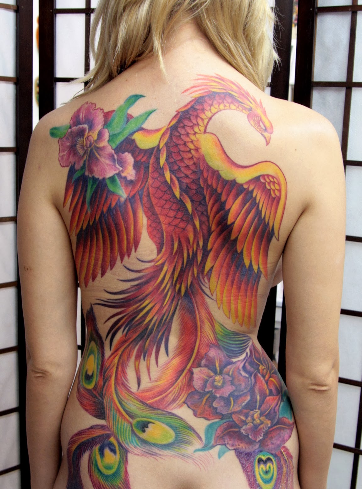 Beautiful color peacock tattoo for girls.