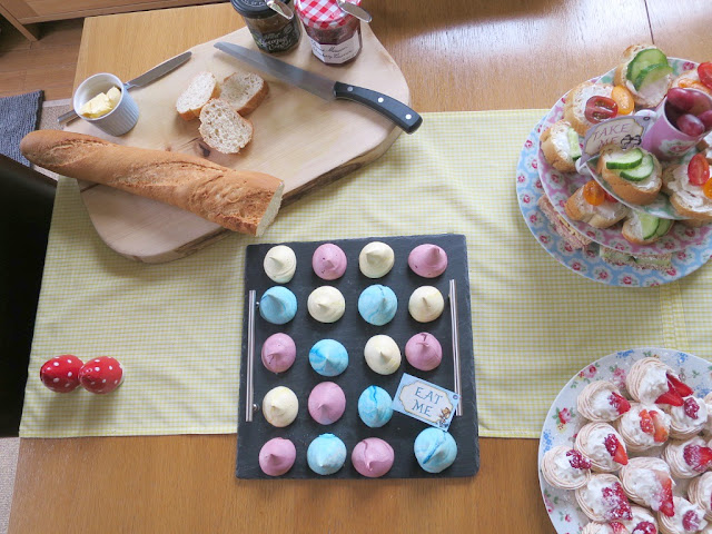 Home made birthday afternoon tea food and drink on Cath Kidston plates perfect for Spring mini meringues in different colours