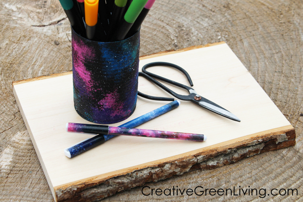Learn how to paint a galaxy to turn an empty can into a cool recycled craft