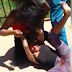 Two girls fight in public... Sadly, one is on her period (graphic video)