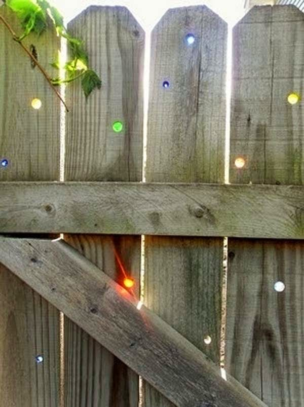 4.) Put marbles in your fence's holes (or drill them yourself). - These 29 Do-It-Yourself Backyard Ideas For Summer Are Totally Awesome. Definitely Doing #10!