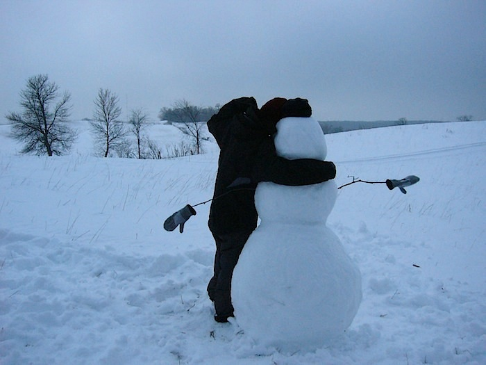 snowman in rural minnesota on freezing January day before heading home for hot beef stew