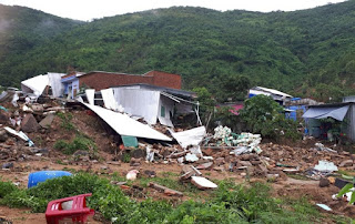 This Sunday, Nov. 18, 2018, photo, shows several houses damaged by landslides in south-central resort city of Nha Trang, Vietnam.