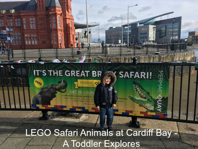 LEGO-Safari-Animals-at-Cardiff-Bay-A-Toddler-Explores-text-over-image-of-boy-in-front-of-sign-at-Cardiff-Bay