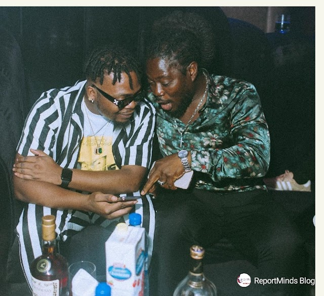 Olamide Pictured With Daddy Showkey -