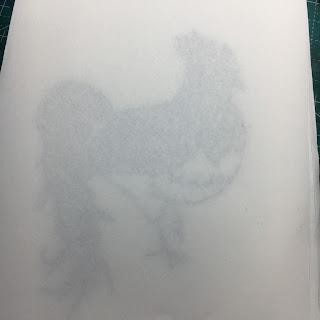 紙の下に切り絵を敷いている図