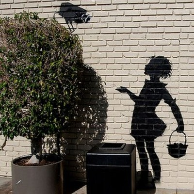 Banksy stencil graffiti, Los Angeles, girl and CCTV camera