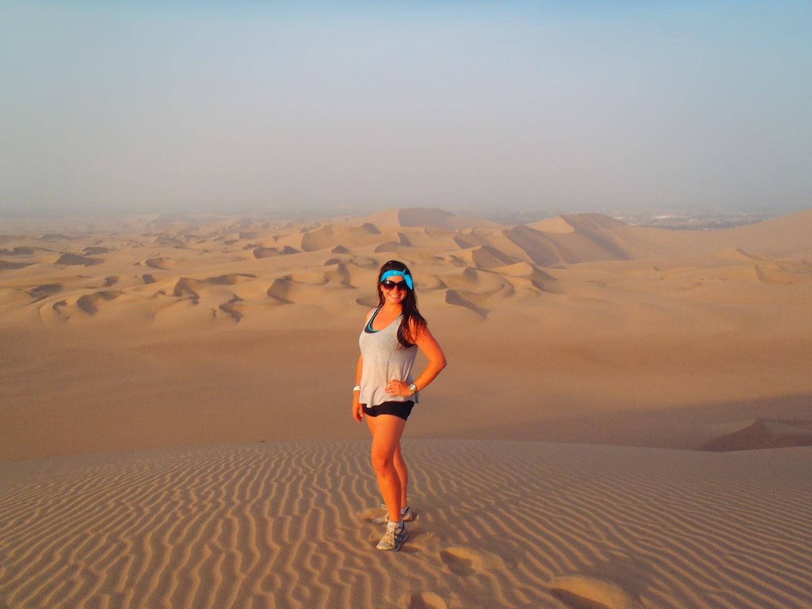 Simone in sand dunes Peru