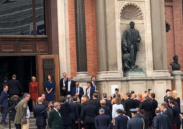 Brigitte Macron wore a dress by Louis Vuitton. Crown Princess Mary wore Stella McCartney cape gown. President Emmanuel Macron