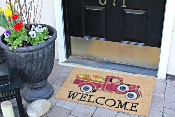 Pickup truck doormat for spring and flowers to add curb appeal