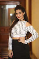 Manjusha in sleevelss crop top and black skirt at Darshakudu pre release ~  Exclusive Celebrities Galleries 091.JPG