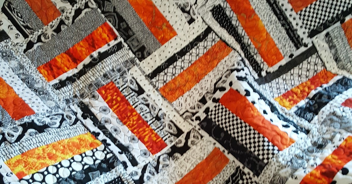 The Pieceful Kingdom Orange And Black Amp White Quilt Done