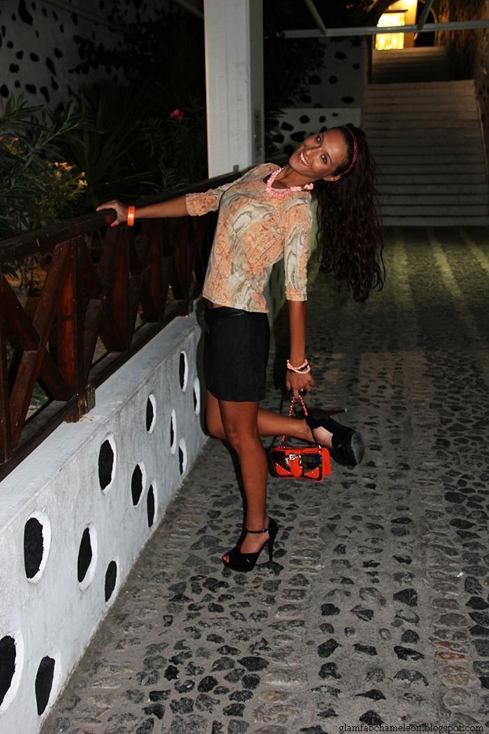 black mini skirt and sandals, orange blouse and accessories