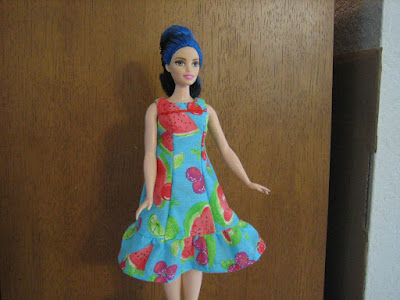 Curvy Barbie in a watermelon princess seams summer dress with ruffle