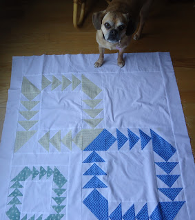 The background is almost done - while Chevy supervises!