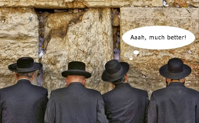 Funny jewish men at the Jerusalem wailing wall praying, one guy urinating joke image