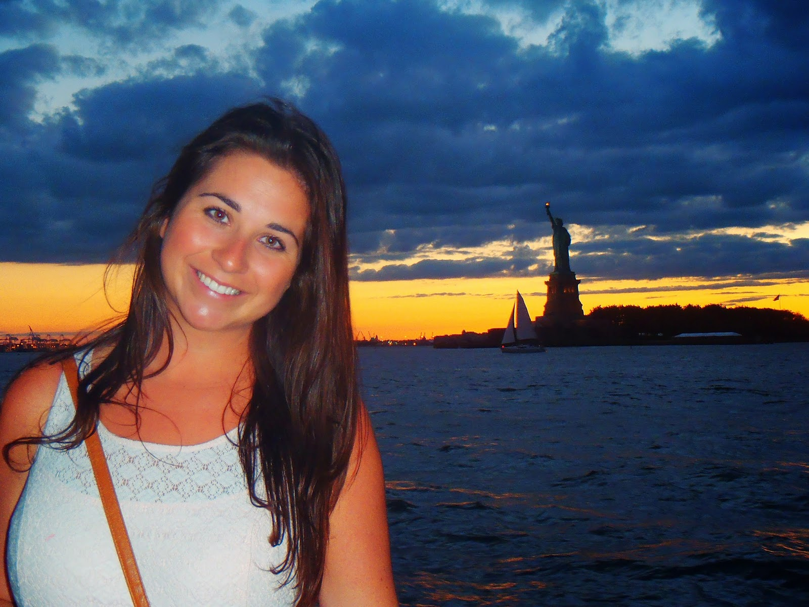 me at sunset in front of the statue of liberty