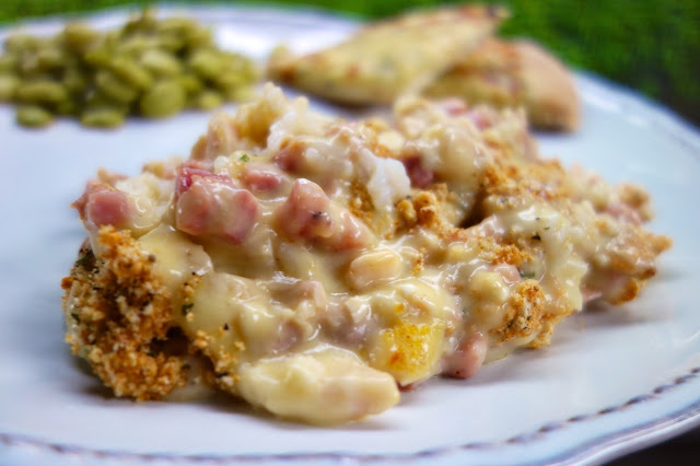 Chicken Cordon Bleu Casserole - seriously delicious!! Packed full of chicken, ham and CHEESE!!! This is super easy to make. Can make it ahead of time and refrigerate or freezer for later. Chicken, ham, swiss cheese, cream of chicken soup, sour cream, milk, dijon mustard, cracker crumbs. Serve with some green beans and rolls. Everyone cleaned their plate! GREAT family friendly casserole! #casserole #chickencasserole #weeknightmeal #familyfriendlymeal