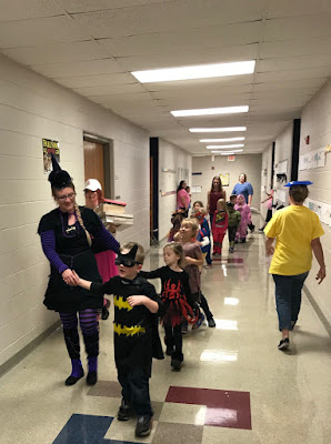 Students dressed in costumes in the hallway walking