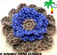 http://www.craftsy.com/pattern/crocheting/accessory/free-double-loop-flower-pdf12-125/77649
