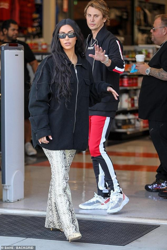 Kim Kardashian commanda attention while out  with best pal Jonathan Cheban