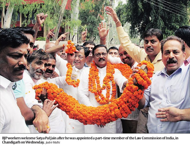 BJP workers welcome Satya Pal Jain after he was appointed a part-time member of the Law Commission of India, in Chandigarh