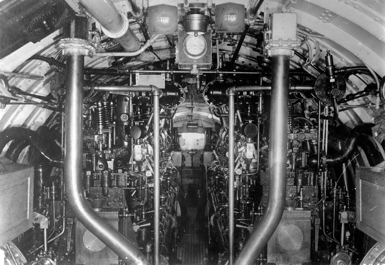The complex inner machinery of a U.S. Submarine, amidships, looking aft.