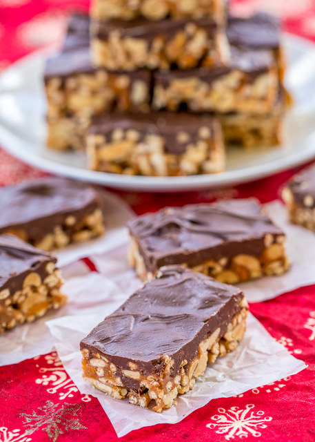 Crunchy Peanut Butter Bars recipe - NO-BAKE treat!!! Chow mein noodles, peanuts, butterfingers, peanut butter, corn syrup, sugar,  and chocolate. These things fly off the plate! Great for parties, cookie exchanges or a homemade gift!! #dessert #nobaketreats #peanutbutter