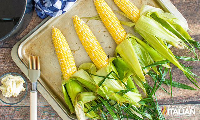 Corn on the cob getting ready to brush with butter