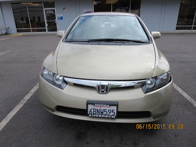 Bumper and headlight askew on 2008 Honda Civic before collision repairs
