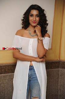 Kannada Model Actress Krishi Thapanda Stills in Ripped Jeans at Eradu Kanasu Movie Press Meet  0002.jpg