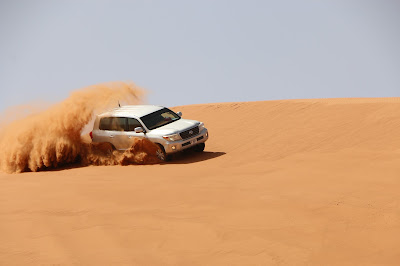 go dubai desert safari land cruiser in desert