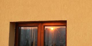 Reflected in the balcony door