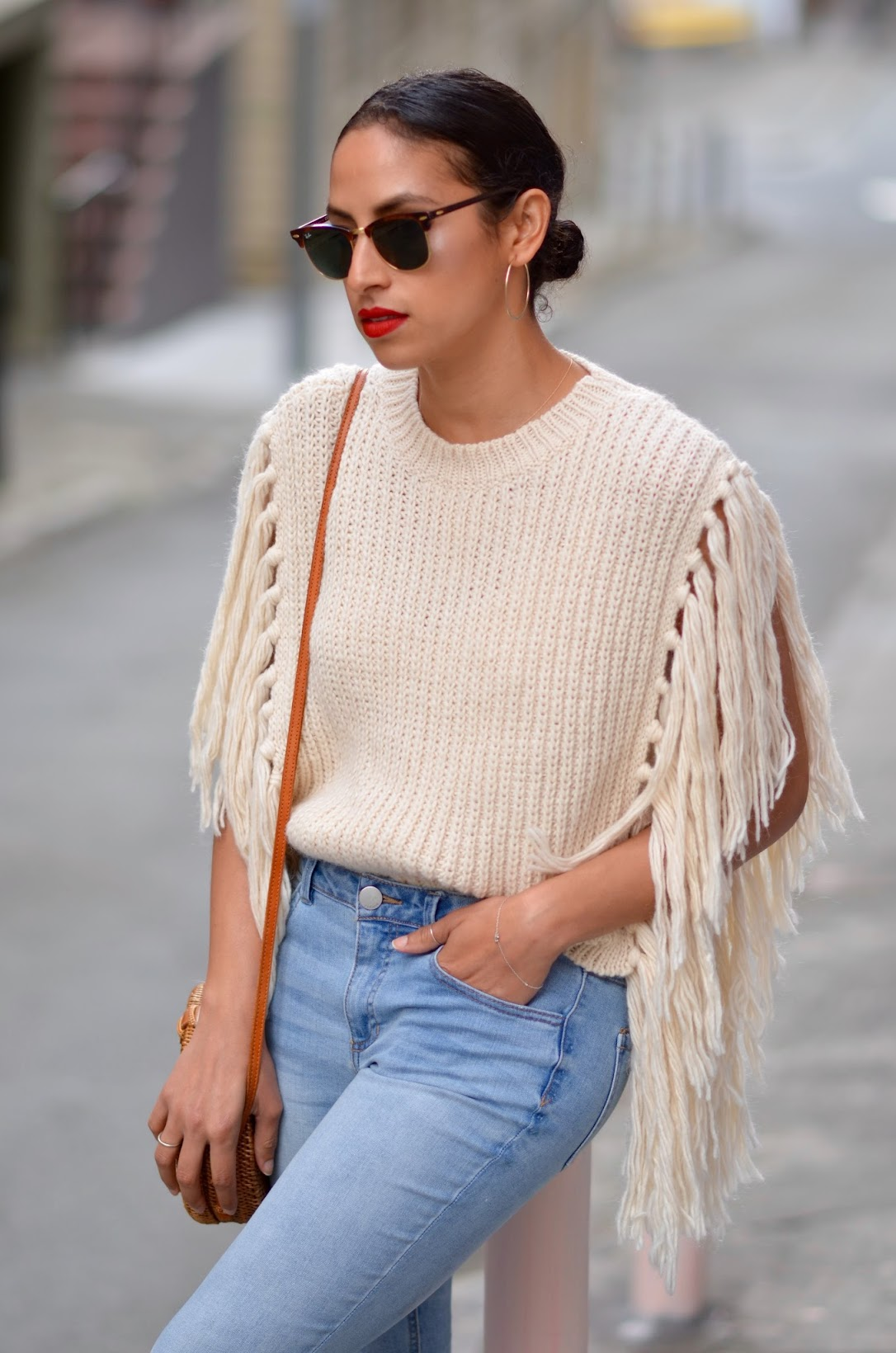 fringe sweater, asos fringe sweater, round basket bag, straw bag from Bali, fringe denim, satin marigold slides, how to wear red lips,