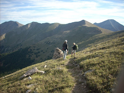 Two ladies hiking along the Continental Divide in the early morning light.