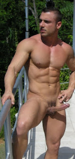 Sexy toned naked man with a nice cock outdoors