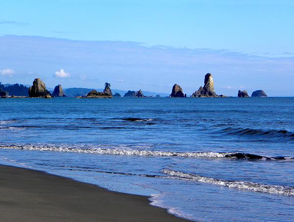 The rocks off Third Beach with ultramarine waves